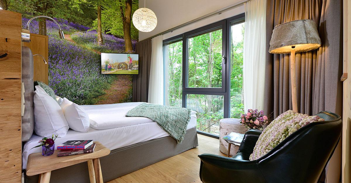 baumchalets bernachten im baumhaus alpenpark neuss. Black Bedroom Furniture Sets. Home Design Ideas